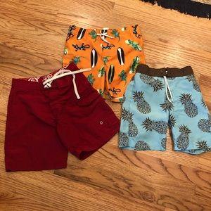 Three colorful pairs of swim trunks